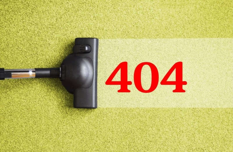 Image of vacuum cleaning up 404 to represent the importance of addressing 404 errors in websites