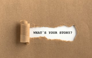 Image of text WHAT'S YOUR STORY? behind torn brown paper to illustrate the important of finding the story behind Google Analytics data
