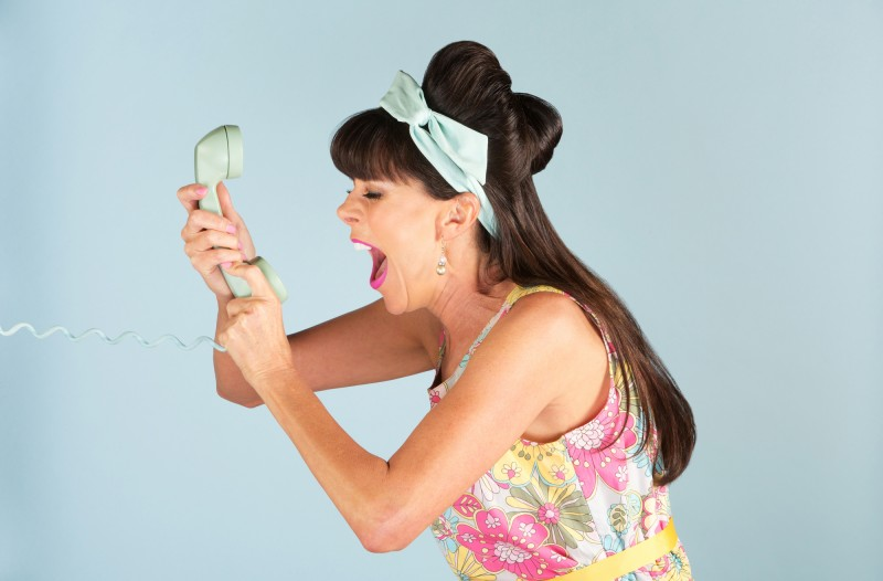 Retro-styled woman making a phone call. Phone calls are an important, but often overlooked, website conversion metric.