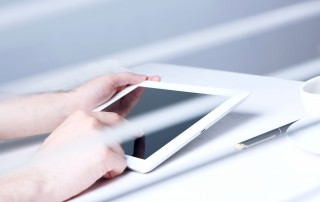 hearing impaired person accesses a website using a tablet. As the number of Federal Website Accessibility lawsuits in the US continues to grow, it will be increasingly important to get your website in compliance.
