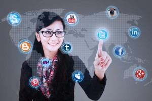 Close-up of businesswoman touching social media applications on a virtual global computer.