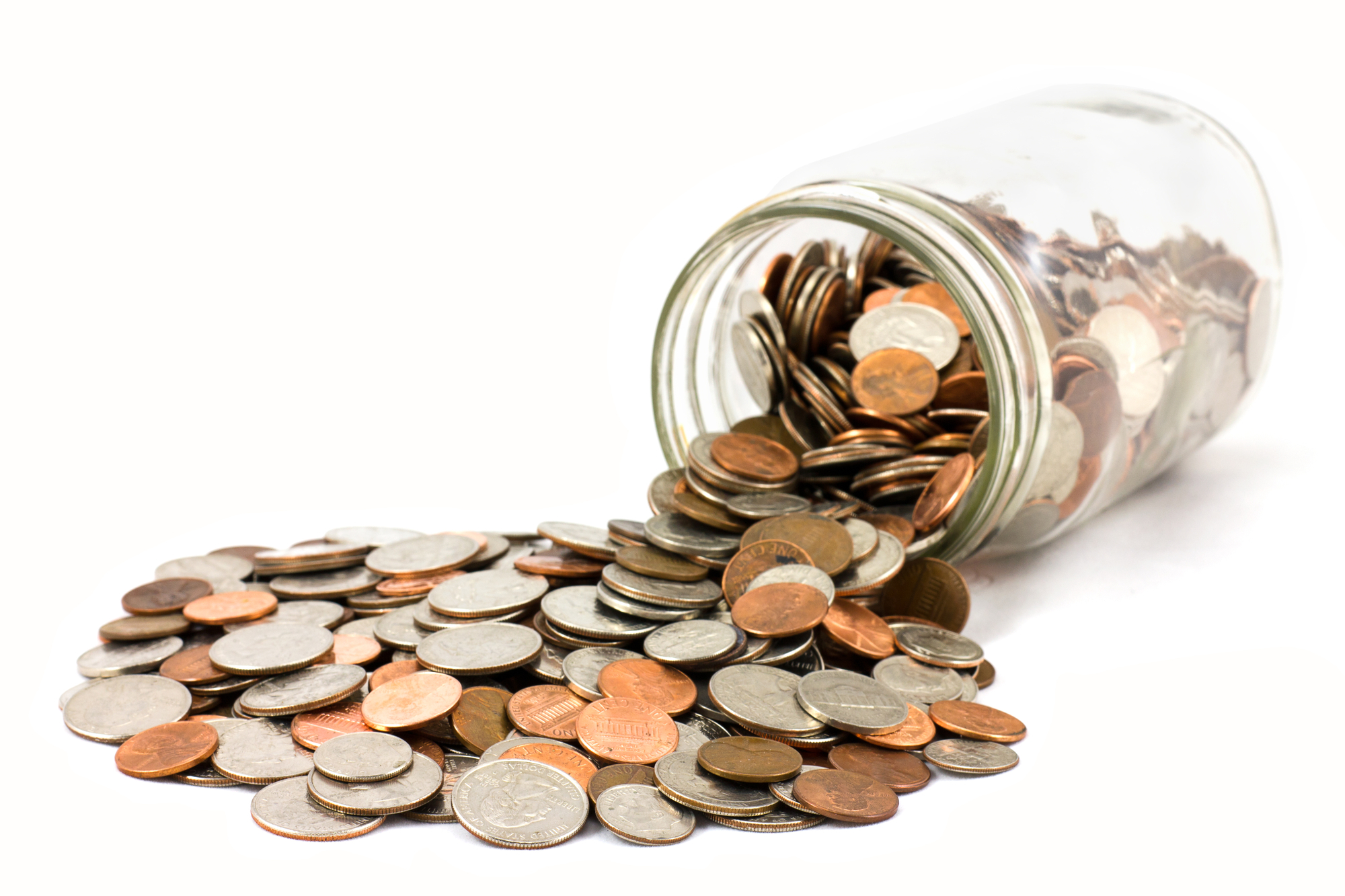 Coins spilling out of a glass jar, signifying running a marketing program with a significantly reduced budget.