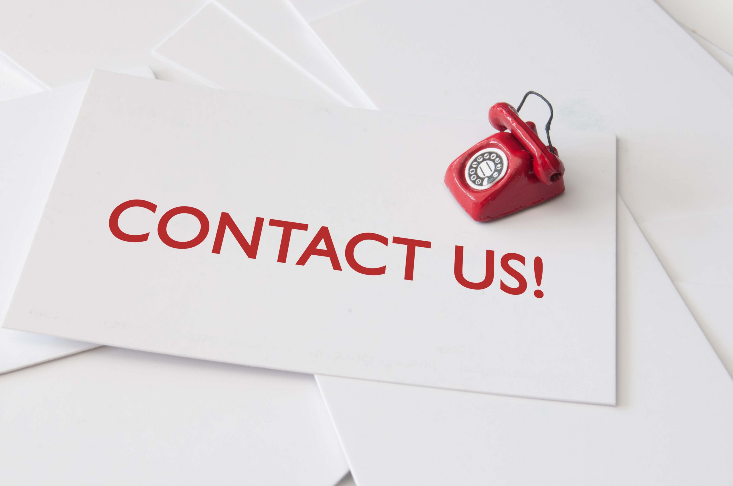 Contact us card with miniature telephone