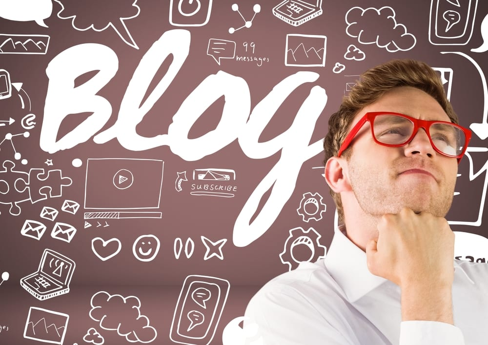 Image of man thinking about blog to represent how much paying someone to write a blog is worth