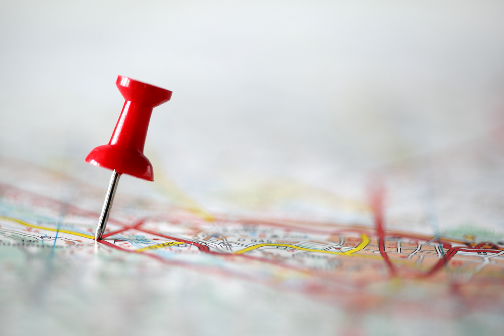 Pushpin in a map, symbolizing Google local pin maps. Google Business listings are valuable for amplifying brand and improving local search visibility.