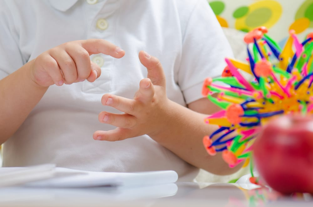 Image of child counting on fingers to represent the concept of how often companies should post blog posts.