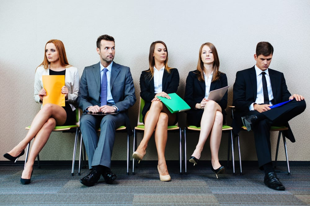 Image of people waiting for job interview to represent whether brands should hire a freelancer or agency for their digital marketing needs.