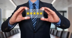 Business person holding a 5 star review.