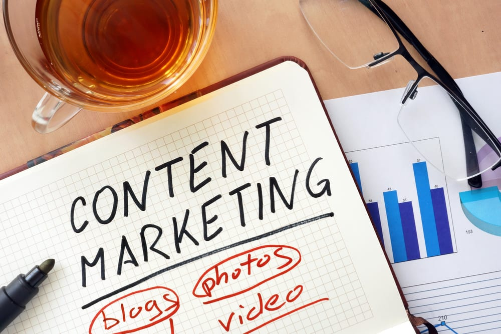 Image of content marketer's desk to illustrate the concept of elements of content marketing and their importance
