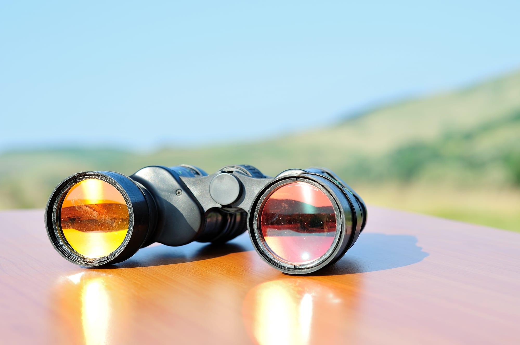 Binoculars, representing zero-click searches.