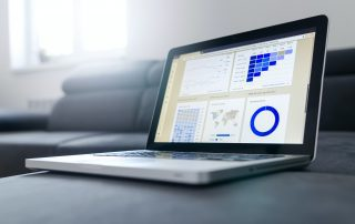 Image of a laptop with Analytics on the screen symbolizing Google Analytics audit agency